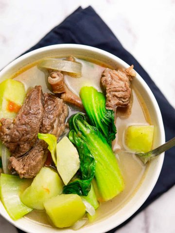 beef ribs sinigang with lemon juice in white bowl