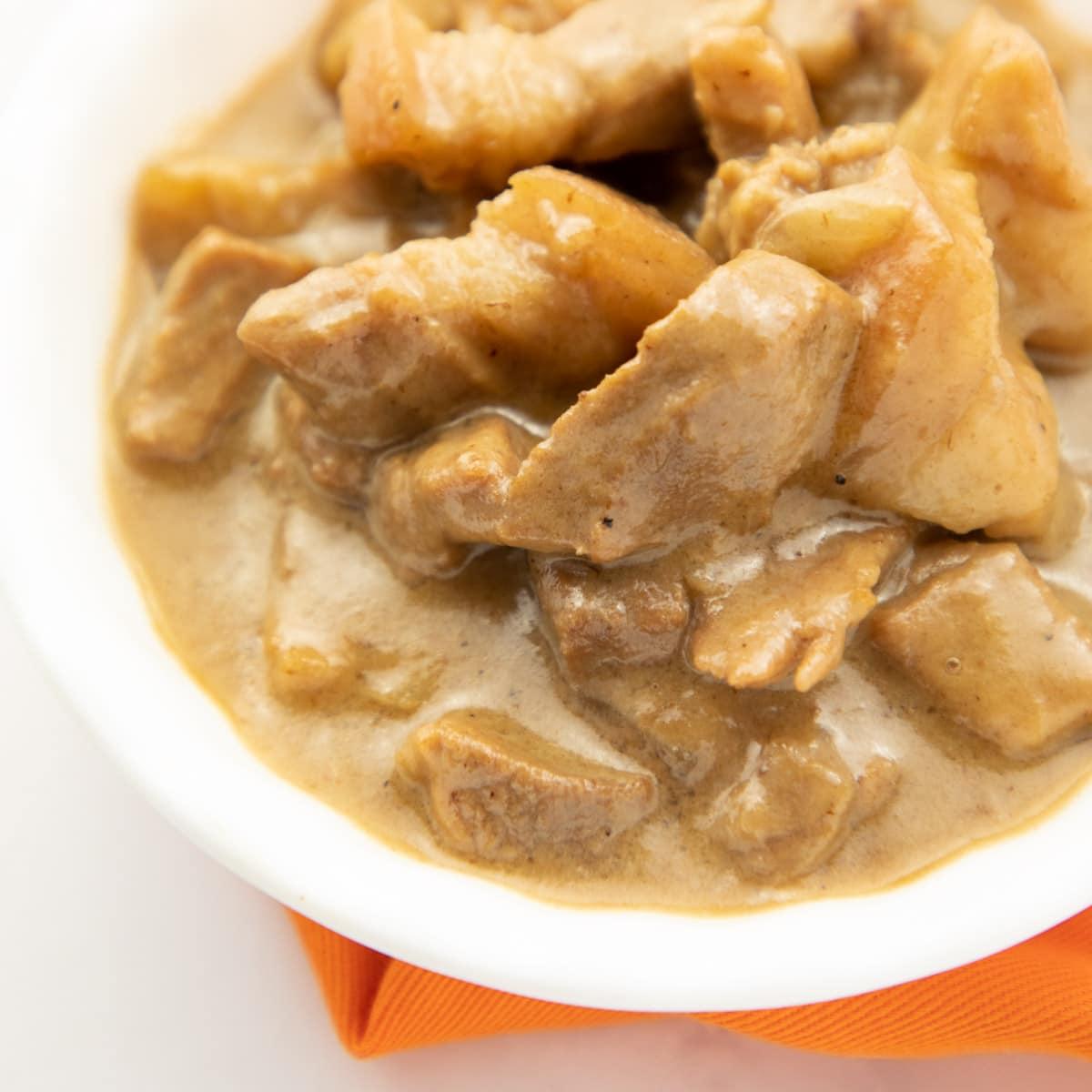 Pork in coconut milk on white bowl